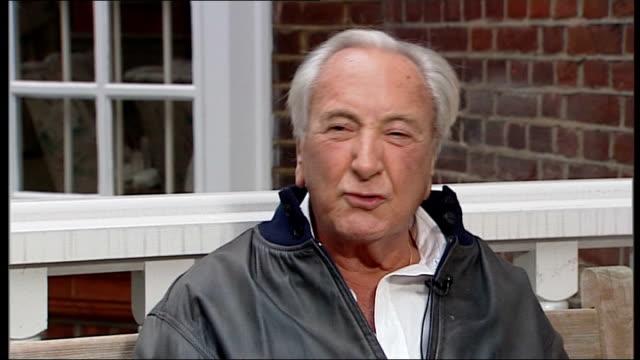 michael winner chatting with reporter and interview sot pays tribute to richard todd - michael winner stock videos & royalty-free footage