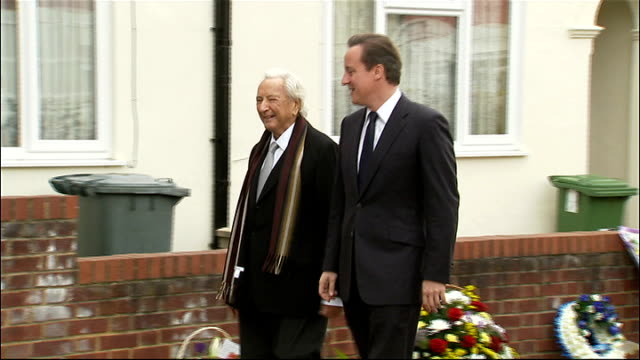 michael winner dies aged 77 lib newham ext michael winner arriving with david cameron mp to unveil memorial to pc gary toms police seated winner... - michael winner stock videos & royalty-free footage