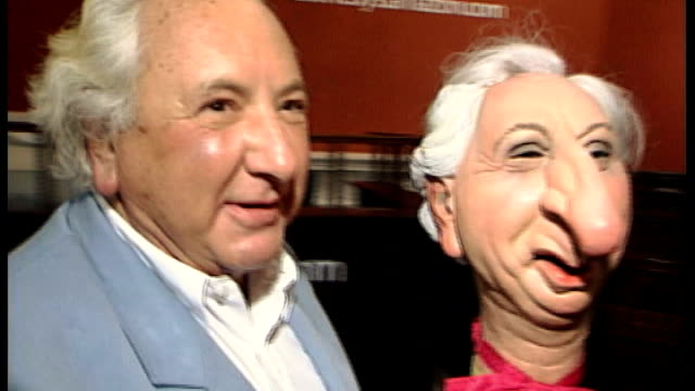 michael winner dies aged 77 t12070023 / london sotheby's photography *** michael winner posing for photocall with spitting image puppet - michael winner stock videos & royalty-free footage