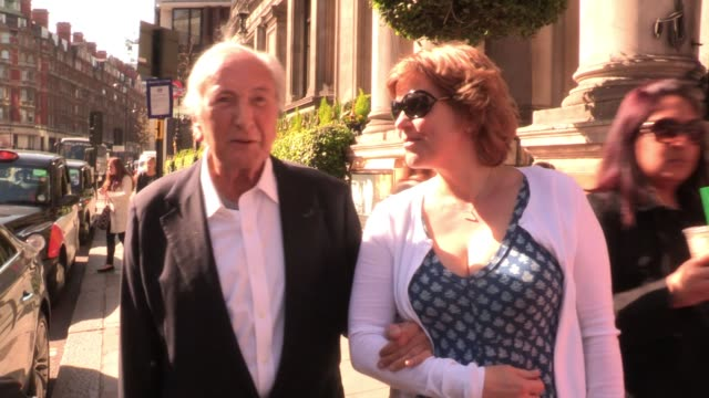 michael winner leaves a central london hotel with a companion sighted michael winner at the mandarin hotel on march 28 2012 in london england - michael winner stock videos & royalty-free footage
