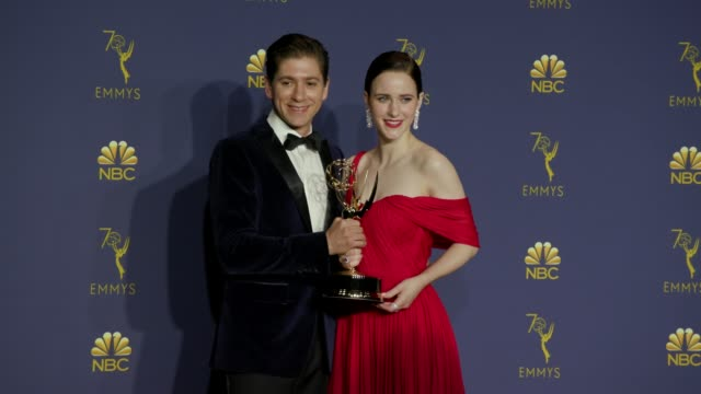 Michael Zegen and Rachel Brosnahan at the 70th Emmy Awards Photo Room at Microsoft Theater on September 17 2018 in Los Angeles California
