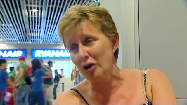 michaela goodings interview sot airport employee reading out names from list sot waiting travellers listening to list being read out british... - identity stock videos & royalty-free footage