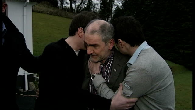 vídeos de stock, filmes e b-roll de three hotel workers appear in court on murder charges county tyrone micky harte being comforted by his two sons - ilhas mascarene