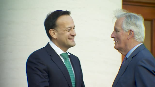 michel barnier eu chief brexit negotiator arrives in dublin and is greeted by irish taoiseach leo varadkar - cheerful stock videos & royalty-free footage