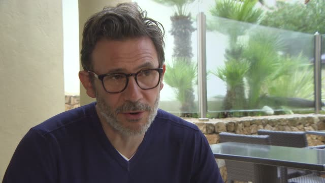 INTERVIEW Michel Hazanavicius on his next film being American and working with his wife Bérénice Bejo at 'The Search' Interviews on May 22 2014 in...
