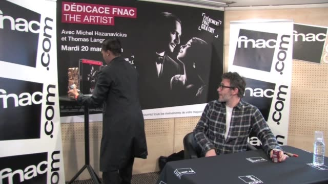 Michel Hazanavicius The Artist director signed autographs and took picture with fans at an official promotion signing at music store la Fnac Michel...