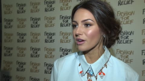 michelle keegan on the event, ebola, her fashion line, eastenders at fashion for relief charity fashion show & interviews at somerset house on... - eastenders stock videos & royalty-free footage