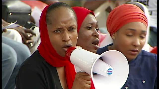 michelle obama calls for release of kidnapped girls in presidential address; nigeria: abuja: ext woman protester chanting into megaphone sot 'we want... - megaphone stock videos & royalty-free footage
