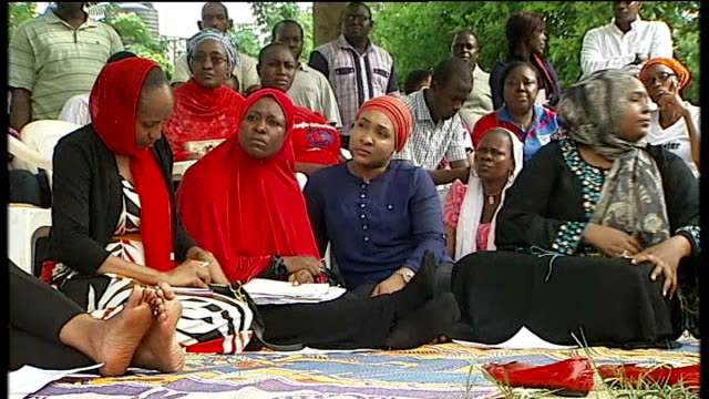 michelle obama calls for release of kidnapped girls in presidential address; nigeria: abuja: ext group of women singing sot - all we are saying,... - schoolgirl stock videos & royalty-free footage