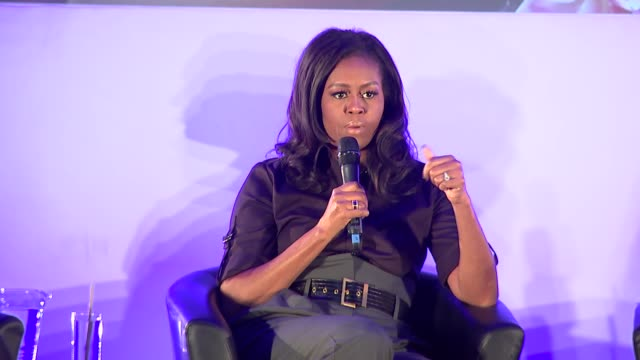 michelle obama revisits elizabeth garrett anderson school in london as she promotes her autobiography and addresses pupils; england: london:... - islington stock videos & royalty-free footage
