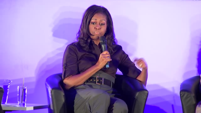 michelle obama revisits elizabeth garrett anderson school in london as she promotes her autobiography and addresses pupils; england: london:... - autobiography stock videos & royalty-free footage