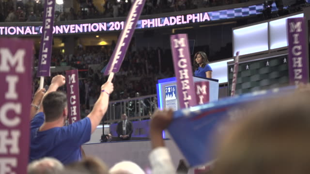 michelle obama speaking at the 2016 democratic national convention, sections of her speech from within the audience, crowd reactions. - demokrati bildbanksvideor och videomaterial från bakom kulisserna