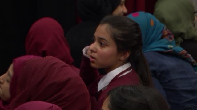 london whitechapel mulberry school for girls int muslim school girls in audience with one waving us flag / various shots muslim school girls / 'let... - variation stock videos & royalty-free footage