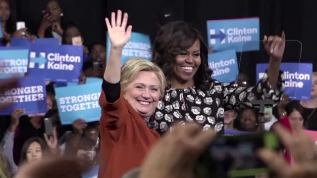 michelle obama surprise star of the 2016 white house campaign hits the trail with democrat hillary clinton as the former and current first ladies... - carolina del nord stato usa video stock e b–roll
