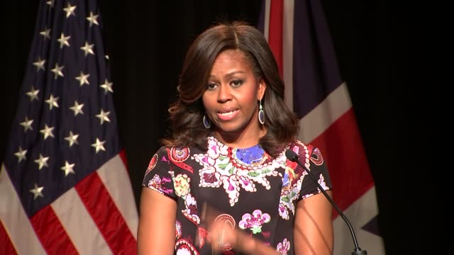 vídeos y material grabado en eventos de stock de michelle obama visits london girls school; michelle obama speech sot - and the world needs more girls like you, growing up to lead our parliament,... - speech