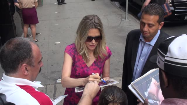 michelle pfeiffer at the 'good morning america' studio with fans in new york ny on 9/11/13 - michelle pfeiffer stock videos & royalty-free footage
