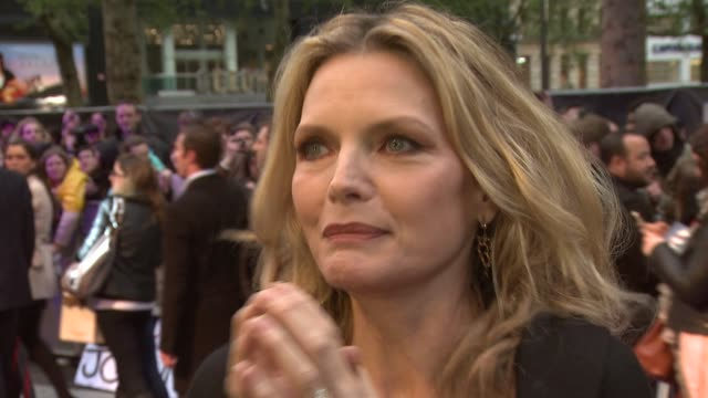 michelle pfeiffer on anne hathaway playing catwoman comparing the original series to the film at dark shadows european premiere at empire leicester... - michelle pfeiffer stock videos & royalty-free footage