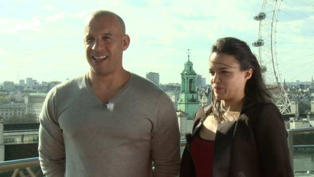 michelle rodriguez and vin diesel make women understand what there's so cool about cars and how the script is so different from the movie on sreen - hormone stock videos & royalty-free footage