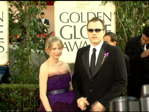 michelle williams and heath ledger at the 2006 golden globe awards arrivals at the beverly hilton in beverly hills, california on january 16, 2006. - heath ledger stock videos & royalty-free footage