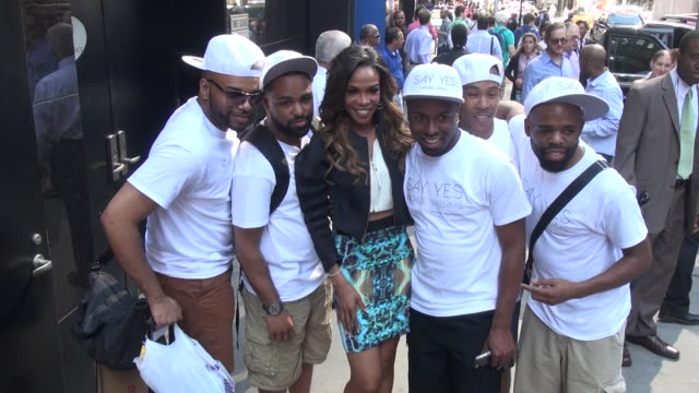 Michelle Williams of Destiny's Child poses with promotional people for her new Album 'Say Yes' in Celebrity Sightings in New York