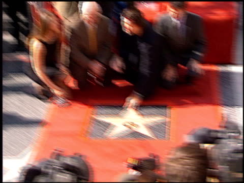 michelle yeoh at the dediction of pierce brosnan's walk of fame star at the hollywood walk of fame in hollywood, california on december 3, 1997. - ピアース・ブロスナン点の映像素材/bロール