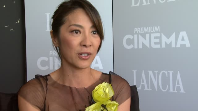 michelle yeoh on her ballet/dancing background the combat choreography at the reign of assassins interviews 67th venice film festival at venice - interview stock videos & royalty-free footage