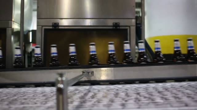 michelob ultra beer is bottled at the anheuser busch budweiser brewery in st louis missouri us steady shot of michelob ultra bottlenecks speeding... - anheuser busch brewery missouri stock videos and b-roll footage