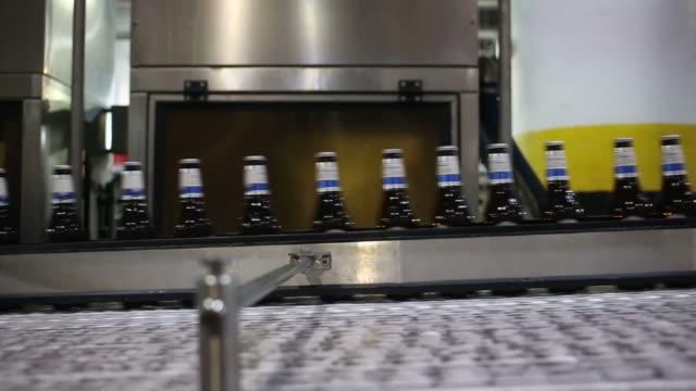 Michelob Ultra beer is bottled at the Anheuser Busch Budweiser Brewery in St Louis Missouri US Steady shot of Michelob Ultra bottlenecks speeding...
