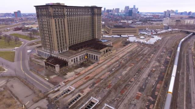 michigan central station and train heading to detroit - detroit michigan stock videos & royalty-free footage