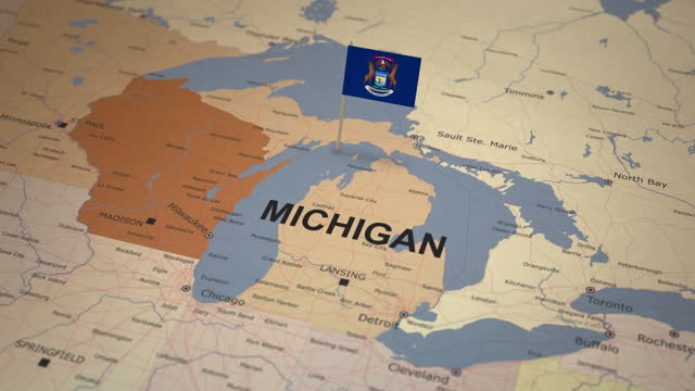 michigan map with state flag - lansing stock videos & royalty-free footage