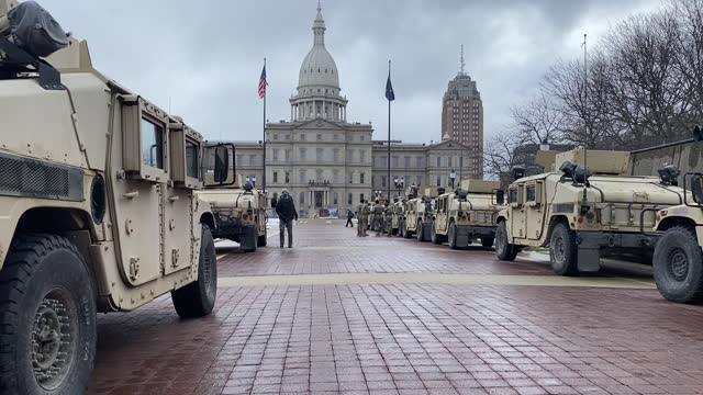 vídeos de stock e filmes b-roll de michigan national guard rearrange outside the michigan state capitol in lansing, mi, u.s., on sunday, jan. 17, 2021. a bulletin this week from the... - lansing