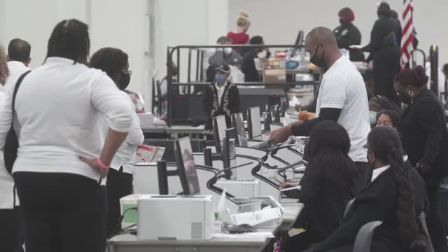 michigan poll workers print ballot receipts at the tcf in downtown detroit in the early morning on november 4 in detroit, michigan. president donald... - receipt stock videos & royalty-free footage