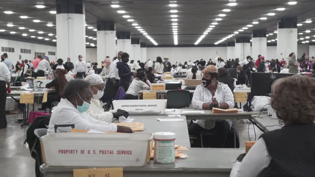 michigan poll workers sort and count ballots at the tcf center on november 4 in detroit, michigan. president donald trump has already declared... - voting ballot stock videos & royalty-free footage