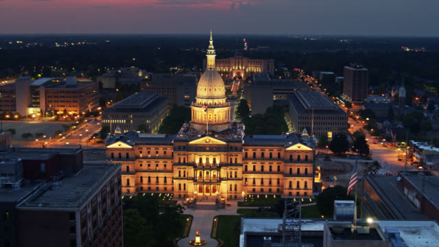 michigan state capitol illuminated at dusk - aerial - lansing stock videos & royalty-free footage