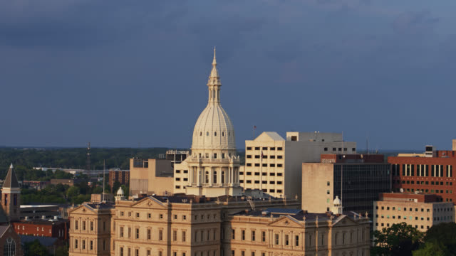 michigan state capitol on overcast afternoon - aerial - lansing stock videos & royalty-free footage