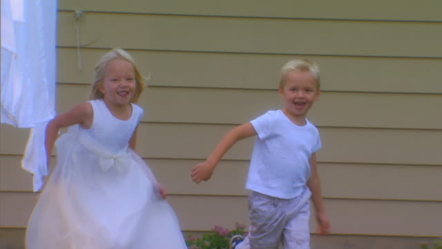 MichiganChildren running in backyard