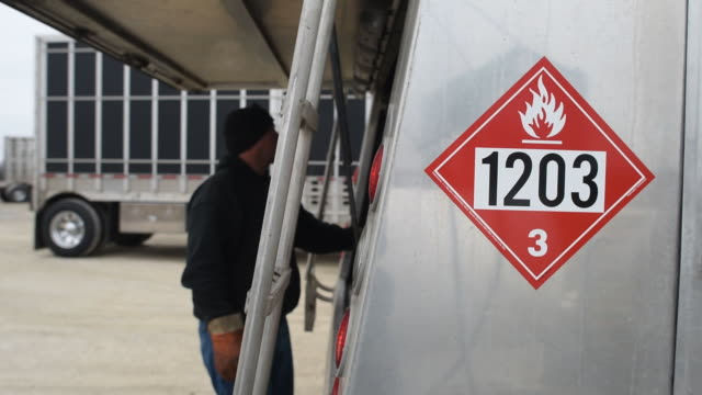 michlig energy driver jake gould delivers unleaded fuel to a bulk tank on a farm in walnut illinois us diesel fuel is delivered to a bulk tank in... - unleaded stock videos and b-roll footage