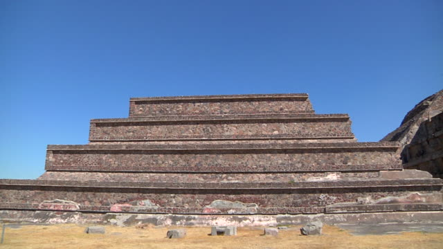 michoacán de ocampo / mexico; november 27 2011: pyramid of the feathered snake, one of the ancient ruins of teotihuacan, has gigants steps and stairs where tourists climb - mayan stock videos & royalty-free footage