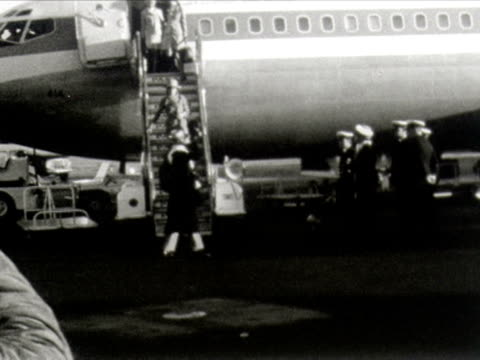 mick jagger and marianne faithfull disembark an aircraft at sydney airport. - rolling stones stock videos & royalty-free footage