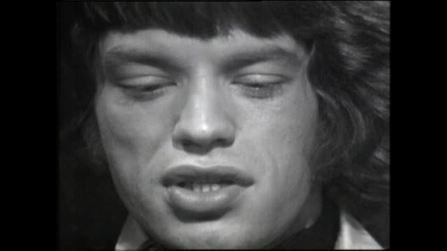 mick jagger in 1967 explains the 'strange feeling of being on stage' and the audience's energy and expectations in the early days of the rolling... - worshipper stock videos & royalty-free footage
