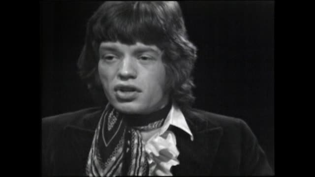 mick jagger speaking in 1967 on how he doesn't feel isolated on stage as he is part of a band and they experience any performance together - interview stock videos & royalty-free footage