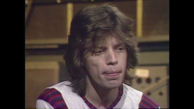 mick jagger speaking in 1972 talks about retaining spontaneity and creativity in the music when writing and recording music - interview stock videos & royalty-free footage
