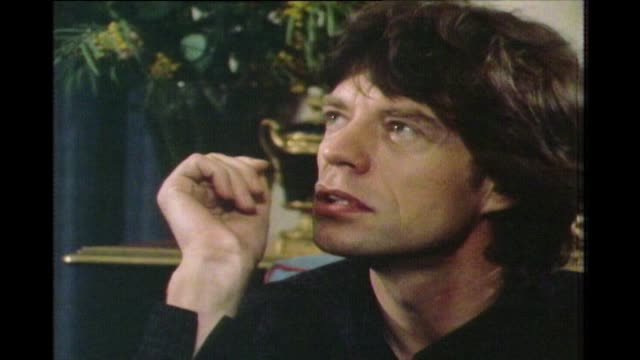 "vídeos de stock e filmes b-roll de mick jagger talks in 1983 on the perception of rock n' roll at it's outset and having a long career in music: ""you can carry on, in rock and roll,... - rolling stones"