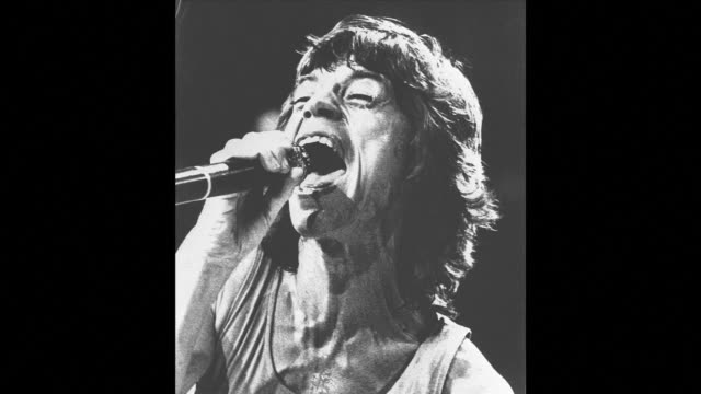 vídeos de stock e filmes b-roll de mick jagger turns 70 tomorrow and though the rolling stones frontman isnt quite the image of rebellious youth he once was he has lost none of his... - rolling stones