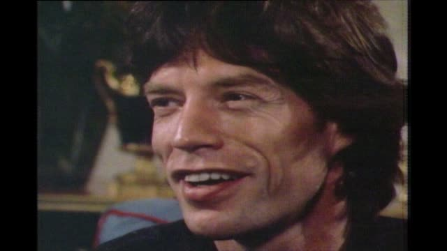 mick jagger's response in 1983 to being asked are you a labour man explaining how he is not a labour supporter or a rightwing conservative - anno 1983 video stock e b–roll