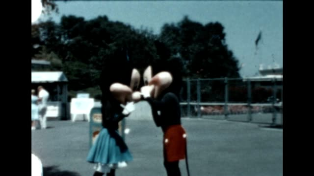 mickey and minnie mouse share a kiss at disneyland - disney stock videos and b-roll footage