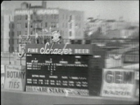 Mickey Mantle hits the a home run over the Ebbet's Field scoreboard to win the World series