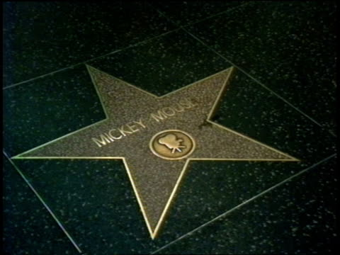 mickey mouse michael jackson stars on walk of fame - ウォークオブフェーム点の映像素材/bロール