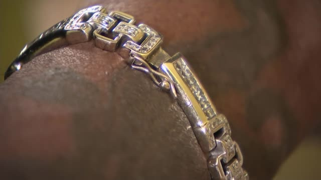 Micro sculptor Willard Wigan Wigan interview SOT Bracelet worn by Wigan Wigan looking into microscope Wigan interview SOT Various of tiny tools used...