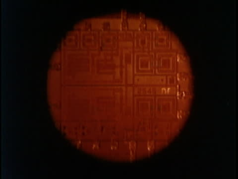 1969 montage microchips, fist pounding blackboard covered with formulas. - mathematisches symbol stock-videos und b-roll-filmmaterial